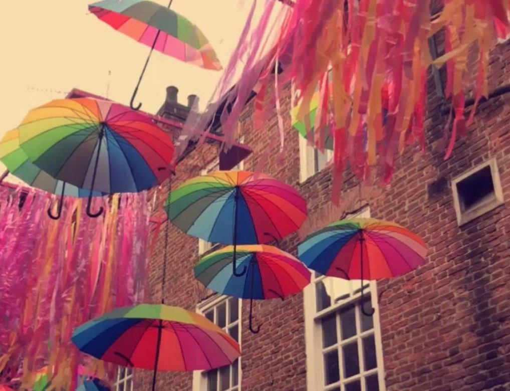 Photo of umbrellas with rainbow colours on it
